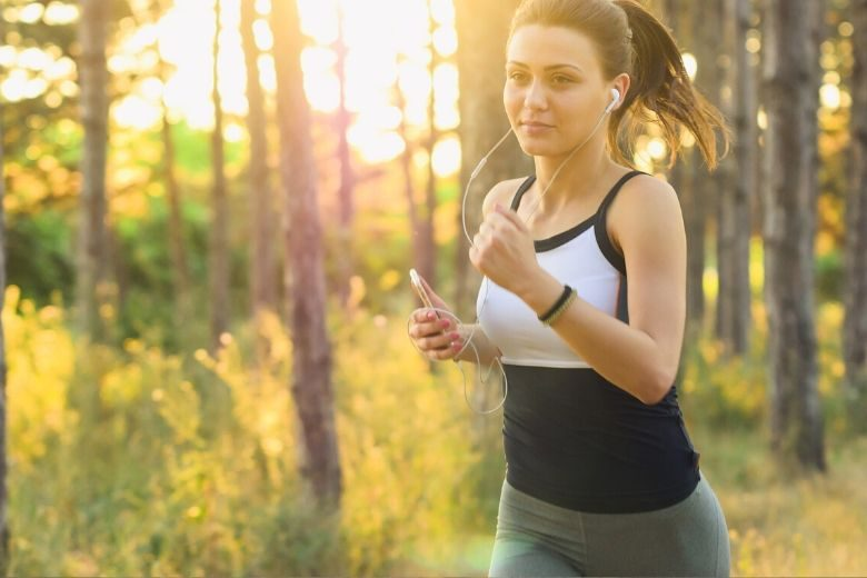 woman running through the woods