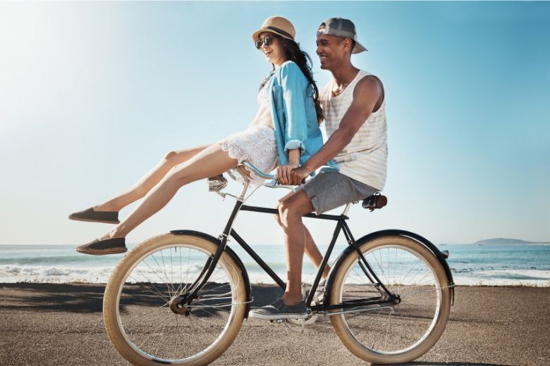 2 people on a bike living life to the fullest