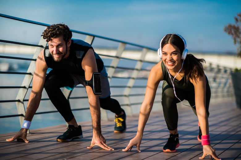 Man and woman having fun while exercising